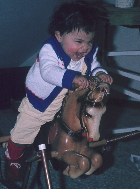 A Young Teresa Psychotically Happy On Her Horsey